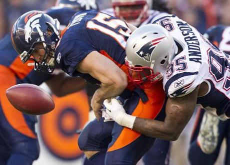 The Patriots' Mark Anderson forced a fumble by Broncos quarterback Tim Tebow during the 41-23 New England victory in Denver.